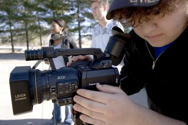 Student with Film Camera