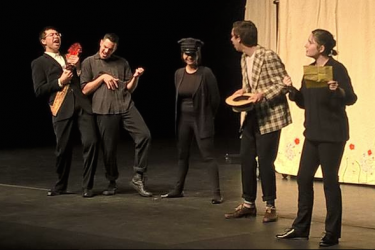 The Lords of Navarre have fun at the humble clown Costard's expense, in Shakes-to-Go's production of Love's Labour's Lost at Watsonville High, 2016.