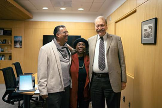 Don Williams, Adilah Barnes, and UC Santa Cruz Chancellor George Blumenthal enjoy a moment of celebration in the chancellor's office last week, where Barnes received the Distinguished Alumni Achievement Award. (photo by Yin Wu)
